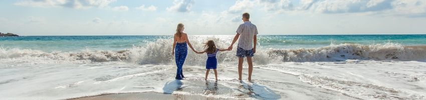 A family of three going on a cheap holiday.