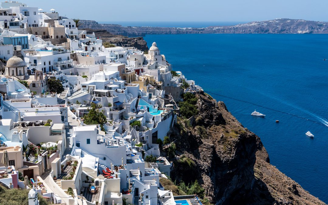 Aerial view of Santorini, Greece with the surrounding islands.